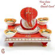 Aapno Rajasthan Diyas and Ganeshji seated on a Chowki with Kundans