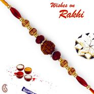 Natural Rudraksh Rakhi with Magenta Beads